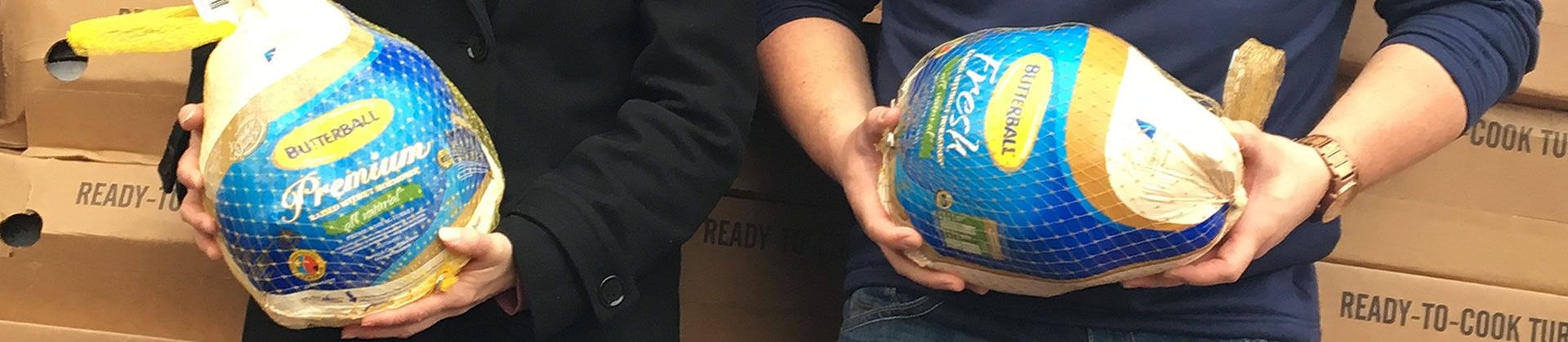 Photo of People Donating Turkeys
